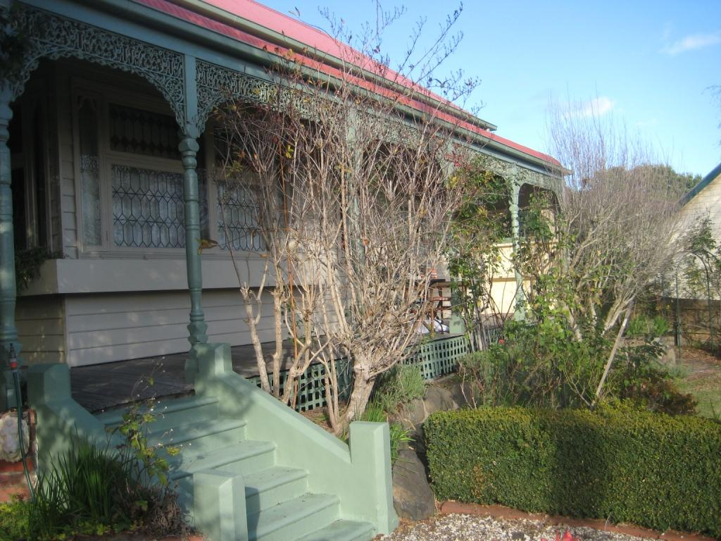 Weatherboard house with lacework